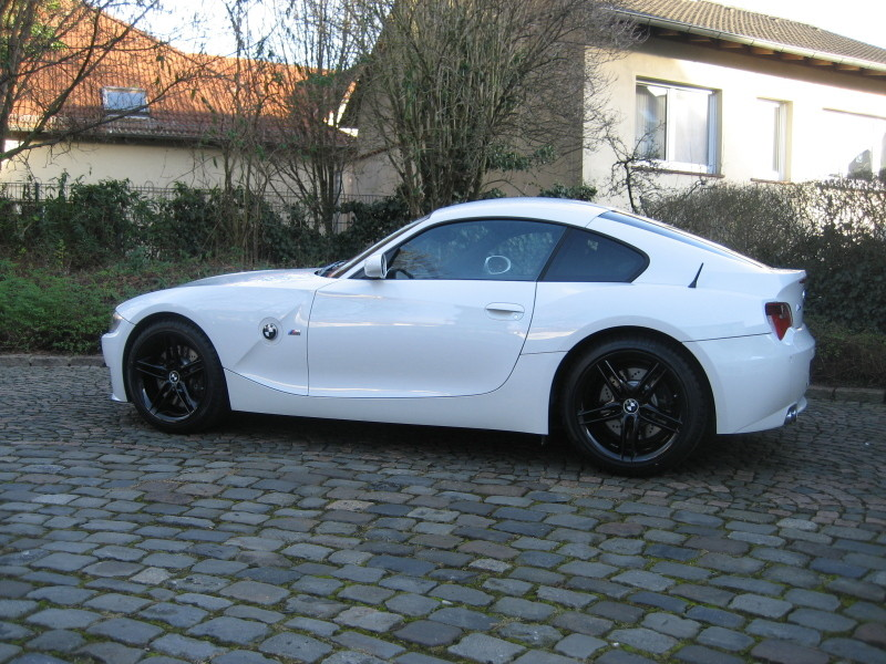 White Coupe Black Rims